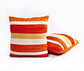 Red orange and white throw pillows on a white background
