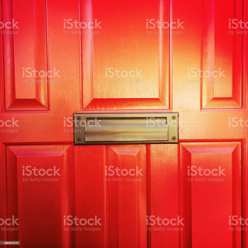 Red Orange Front Door with Mail Slot stock photo