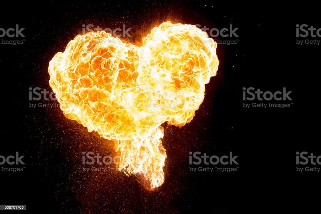 Red orange hot fire love heart isolated on black background stock photo
