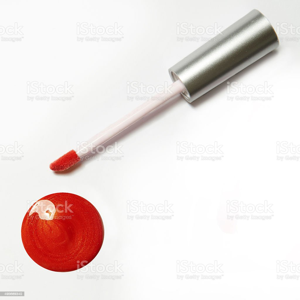 red orange lip gloss package on white background stock photo