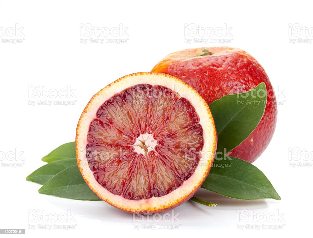 Red oranges with leaves on a white background stock photo