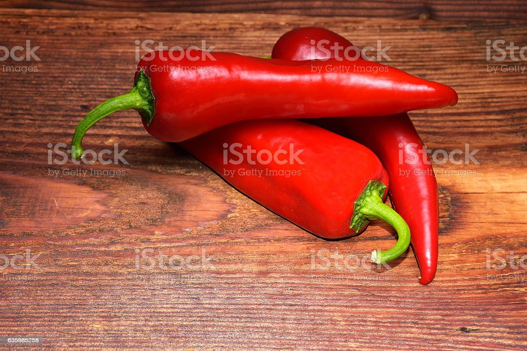 red organic paprika on wood background stock photo