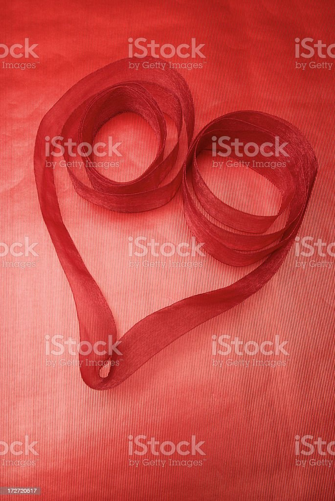 Red Organza Ribbon Heart on Foil Paper royalty-free stock photo