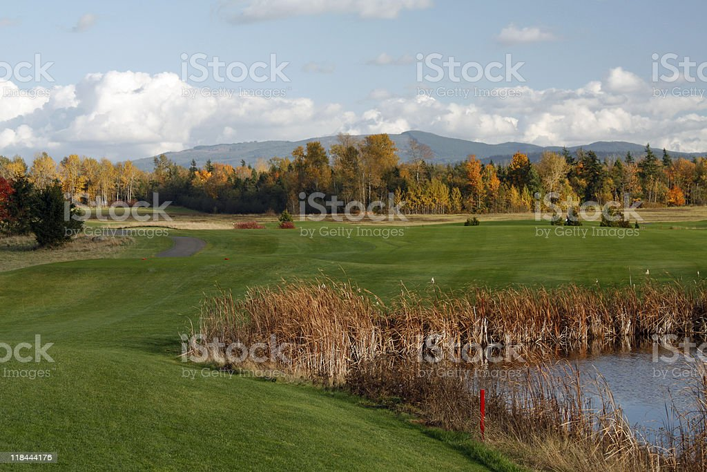 Red Out of bounds pin on water hazard autumn golfcourse royalty-free stock photo