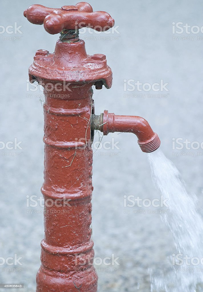 Red Outdoor Water Faucet stock photo
