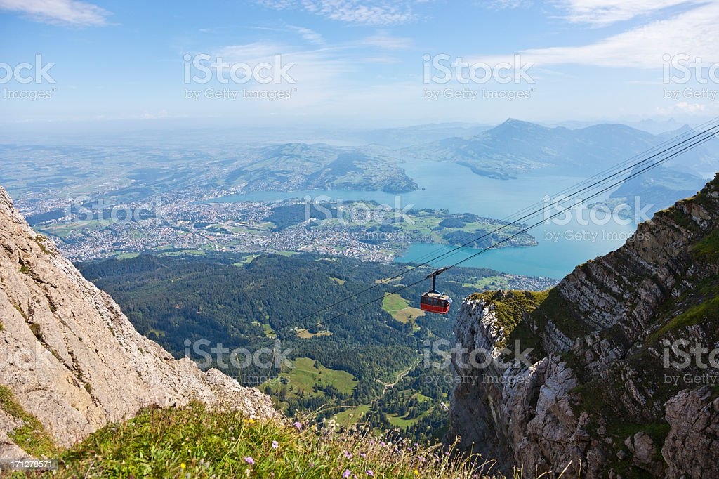 Red Overhead Cable Car in Swiss Alps stock photo