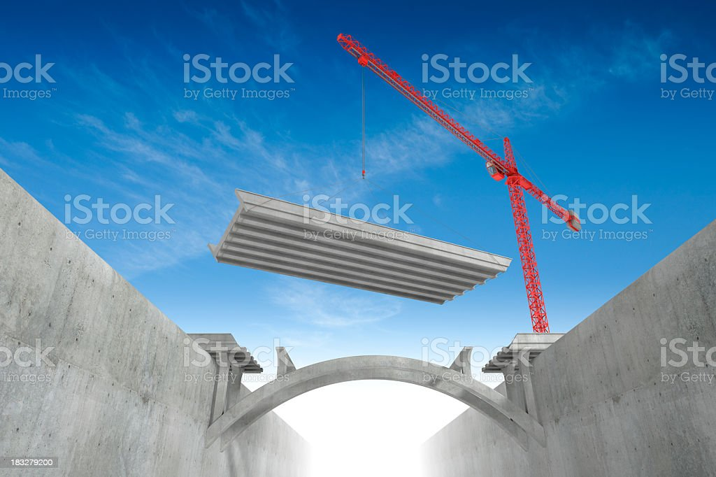 Red overhead crane building bridges stock photo