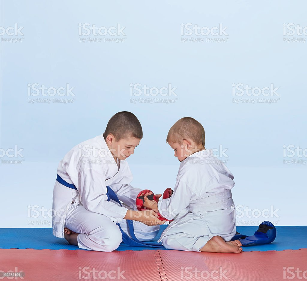Red overlays little brother helping  to dress brother stock photo