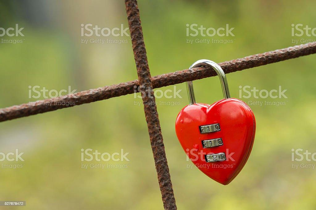 Red padlock in heart shape. stock photo