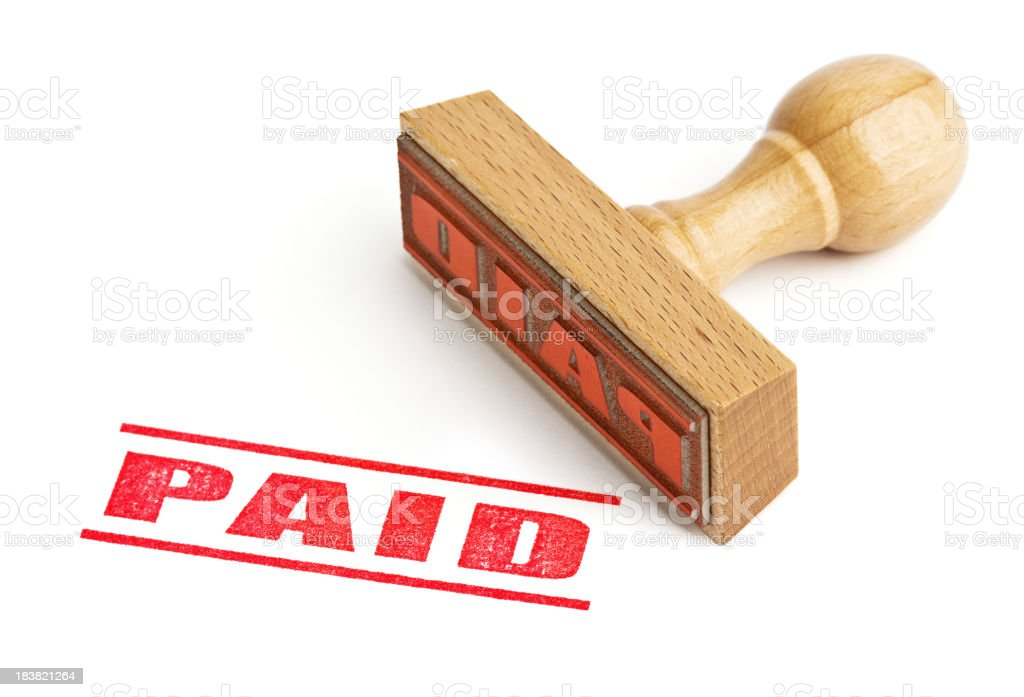 Red paid sign stamp against white background stock photo