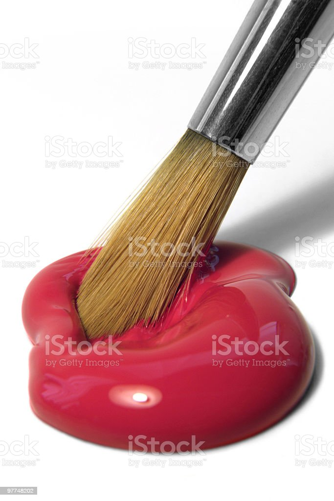 red paint and brush tip royalty-free stock photo