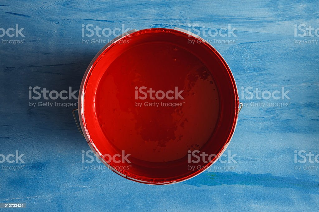 Red paint box on blue background stock photo