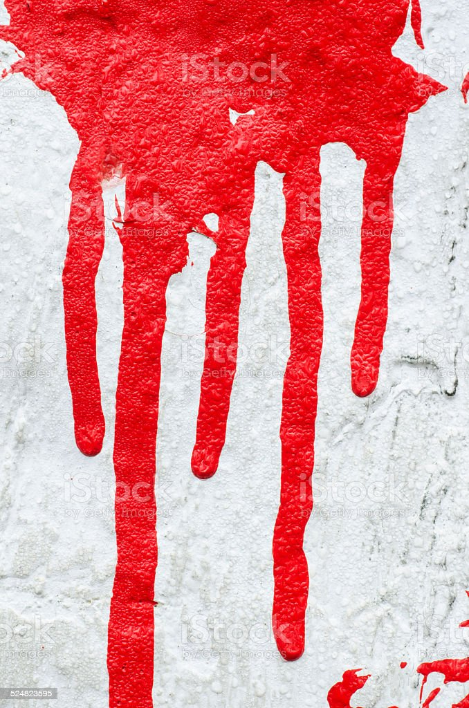 red paint drips on white background stock photo