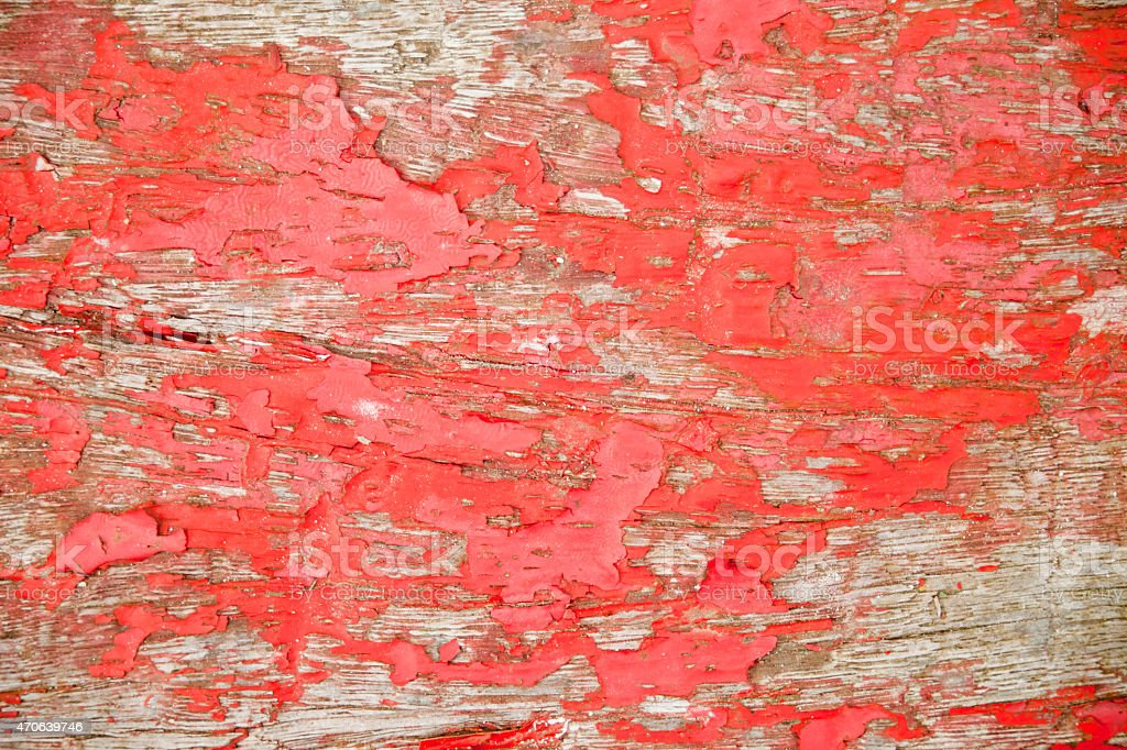 Red paint flaking off stock photo