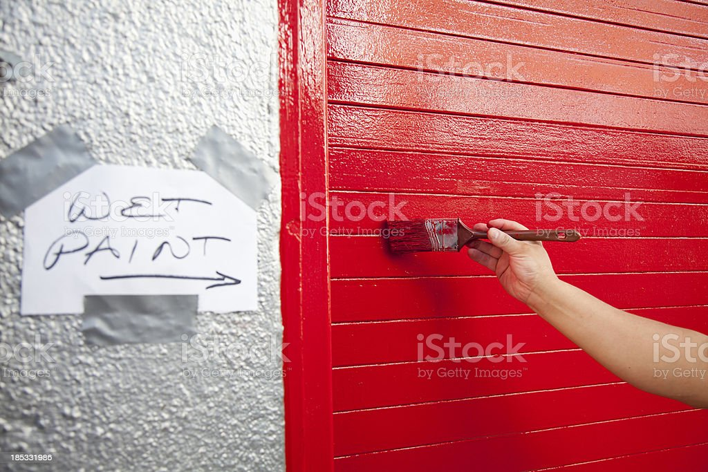 Red Paint: Hand Holding Brush royalty-free stock photo