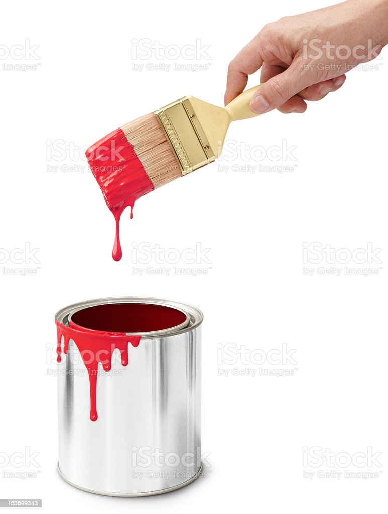 Red paint in can and dripping from brush stock photo