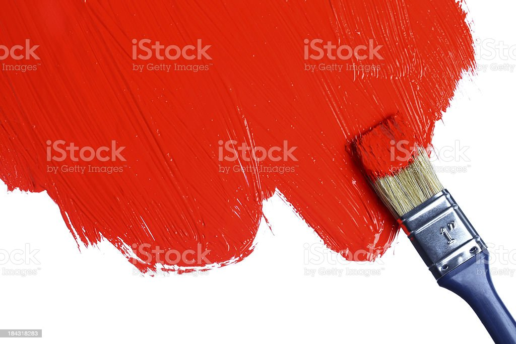 Red paint on a paintbrush stock photo