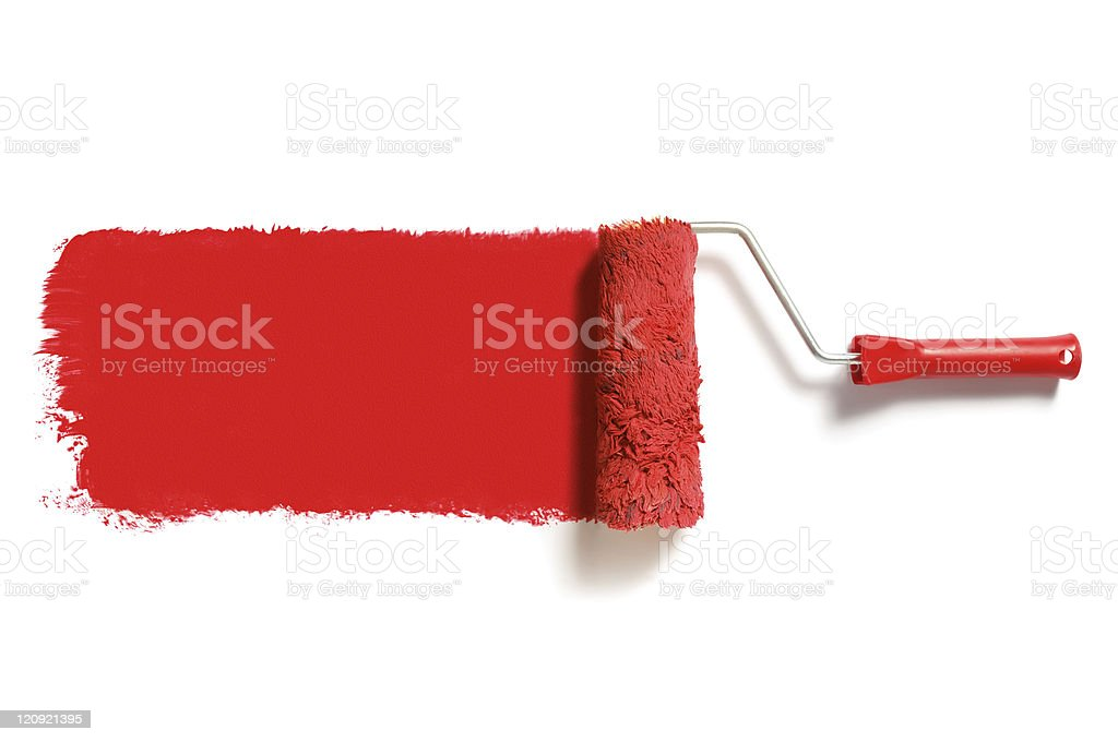 Red paint on a white wall with paint roller stock photo