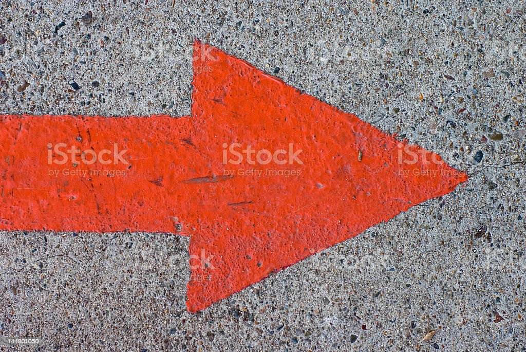 Red Painted Arrow on Concrete stock photo