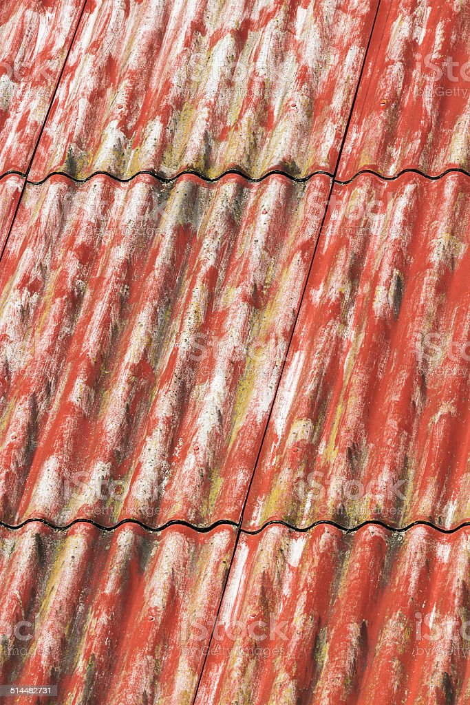 Red painted asbestos roof stock photo