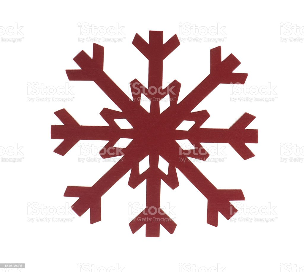 Red painted wooden snowflake on white background royalty-free stock photo