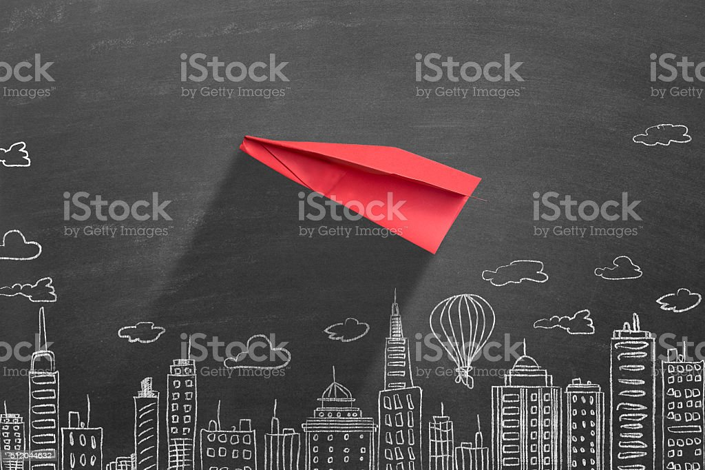 Red paper airplane stock photo
