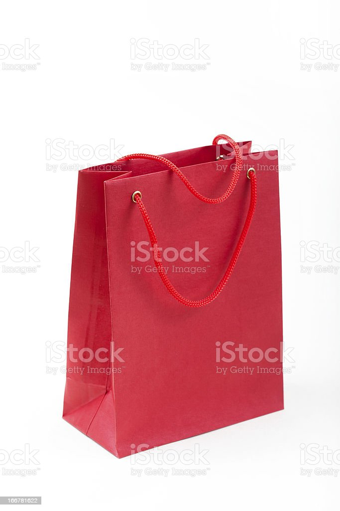 Red paper bag closeup  on white background royalty-free stock photo