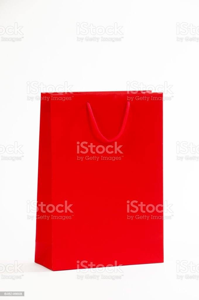 Red paper bag on a white background stock photo