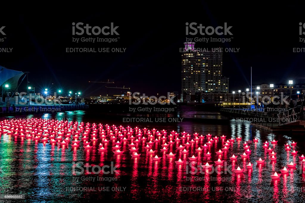 Red Paper Boats On Water--Light City Baltimore 2016 stock photo