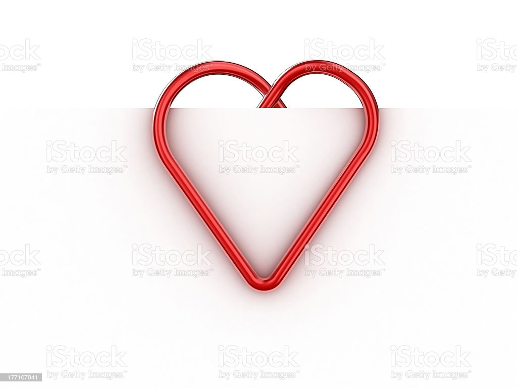 Red paper clip turned into a love heart stock photo