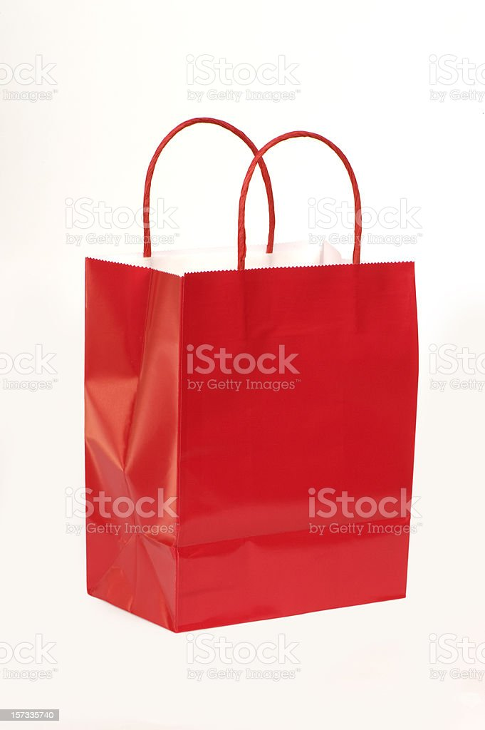 Red paper gift bag with handles royalty-free stock photo