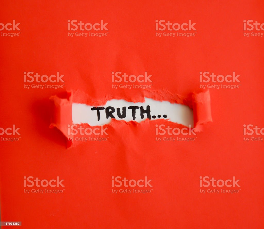 Red paper revealing the truth underneath stock photo