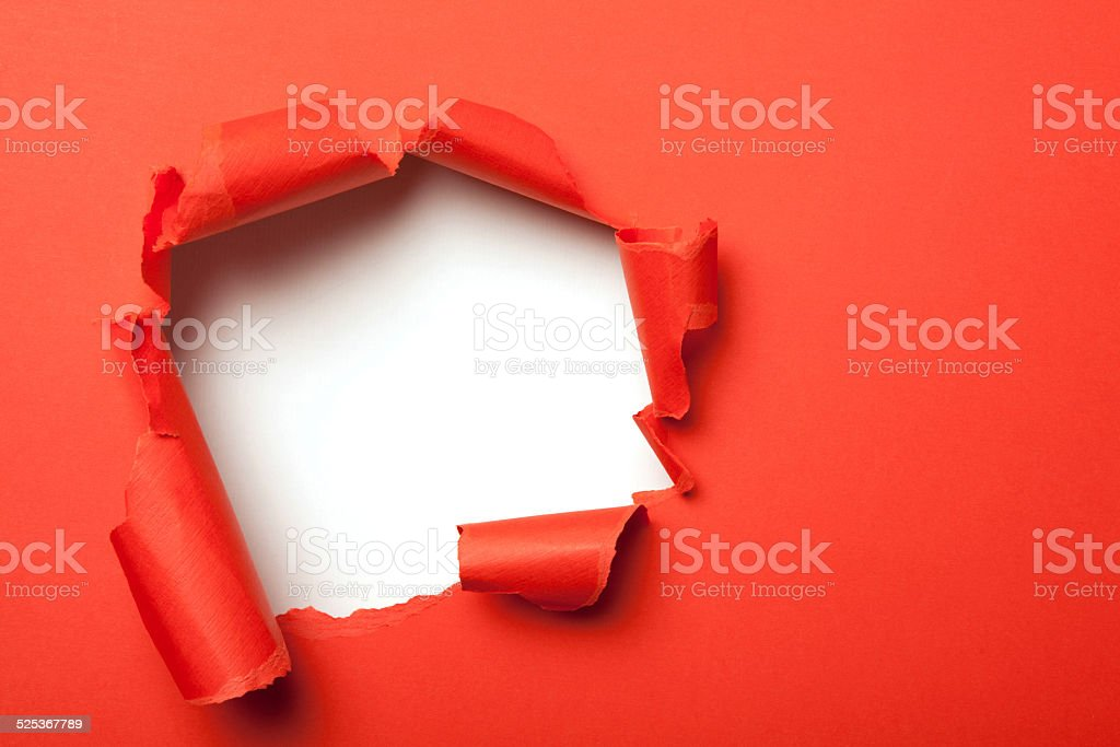 Red paper with hole stock photo