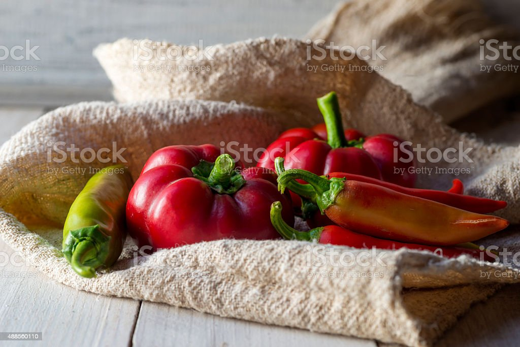 red paprika and pepper on a wooden table stock photo