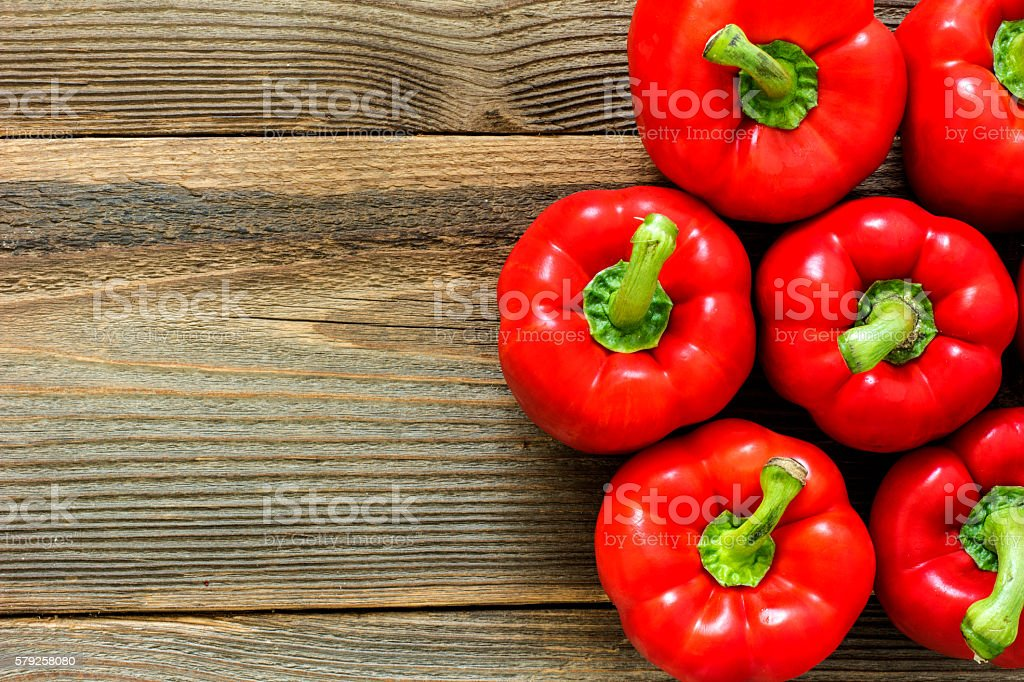 Red Paprika On The Wooden Table stock photo