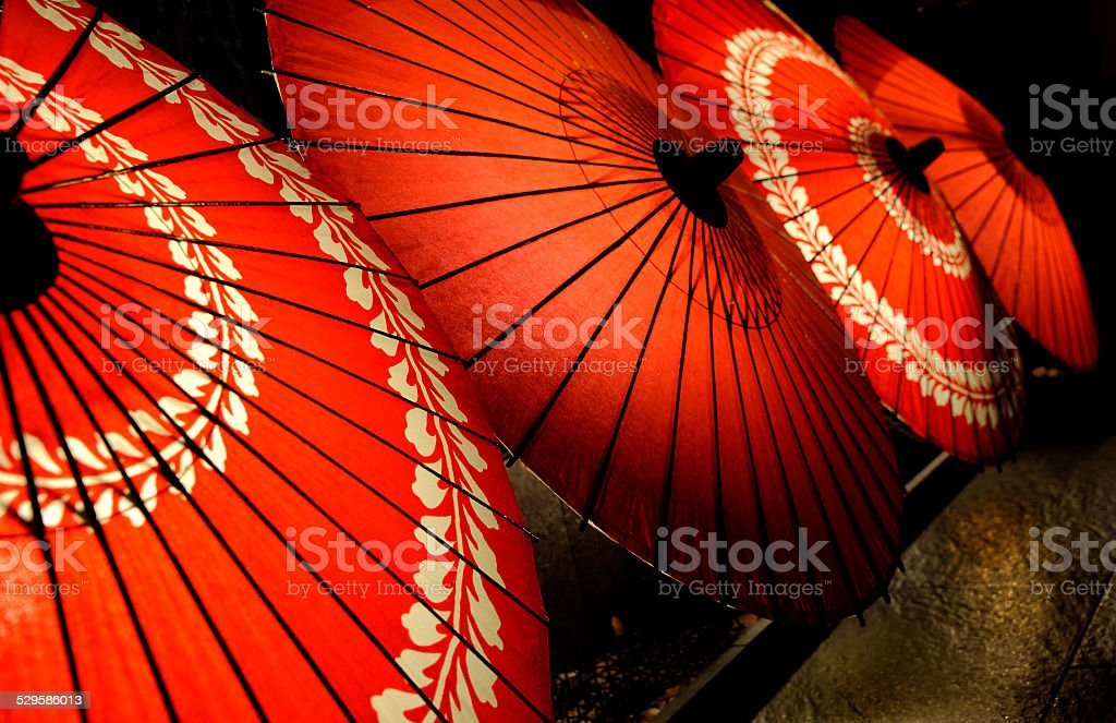 Red parasols stock photo