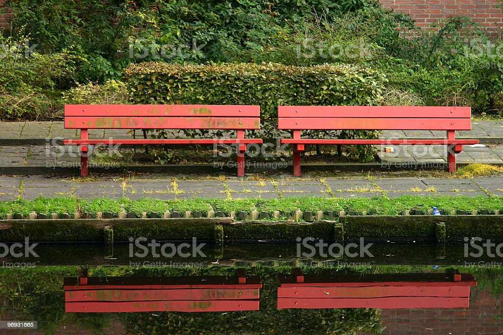 red park bench stock photo