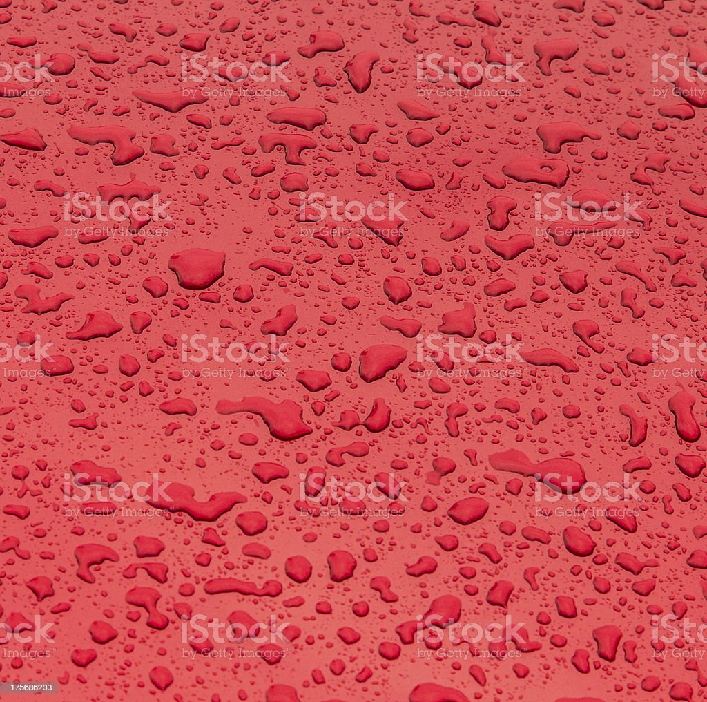 red pattern of raindrops at a metal surface royalty-free stock photo