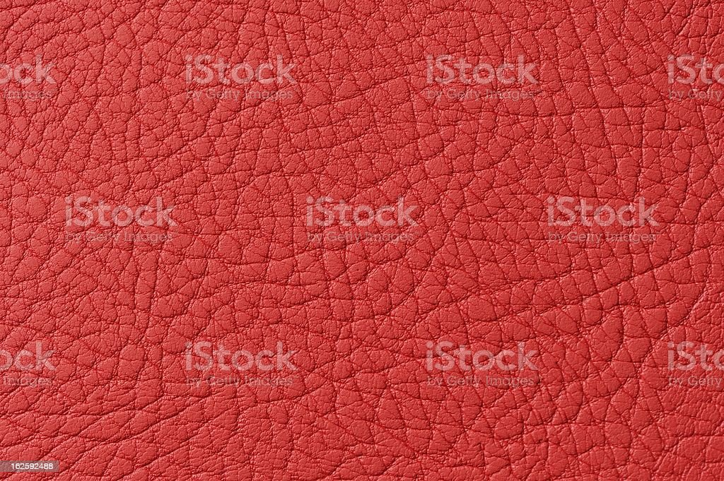 Red Patterned Faux Leather Texture Macro royalty-free stock photo