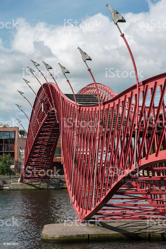 Red pedestrian bridge in Amsterdam over the river stock photo