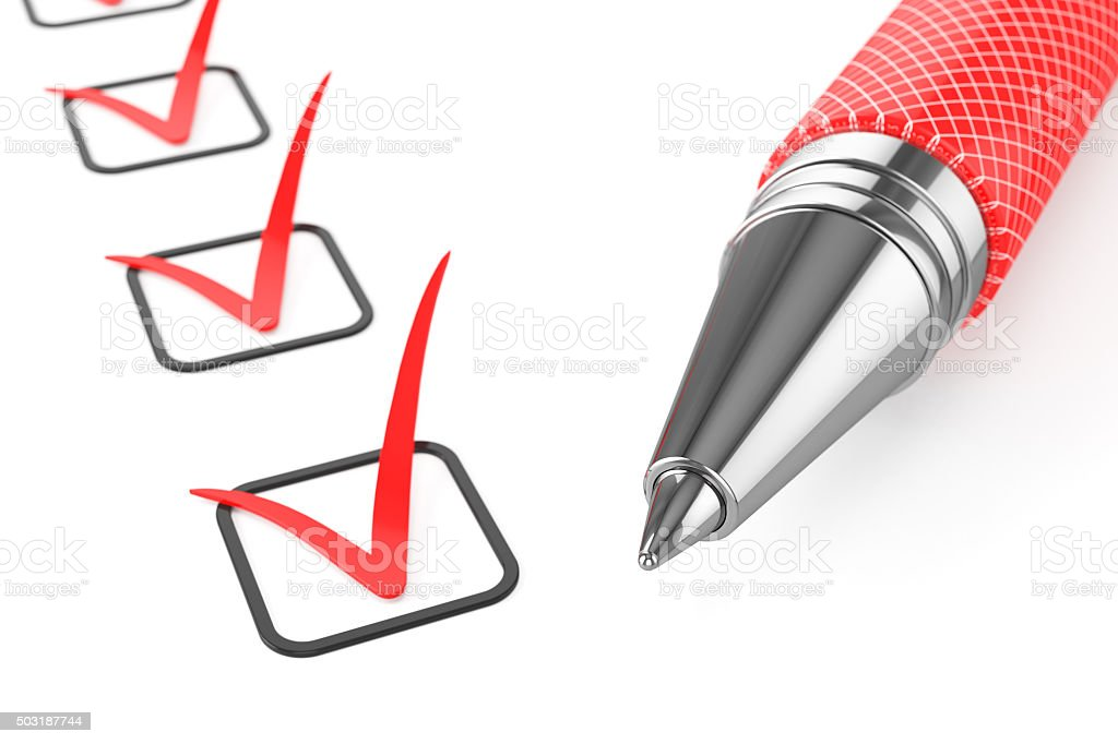 Red pen on checklist stock photo