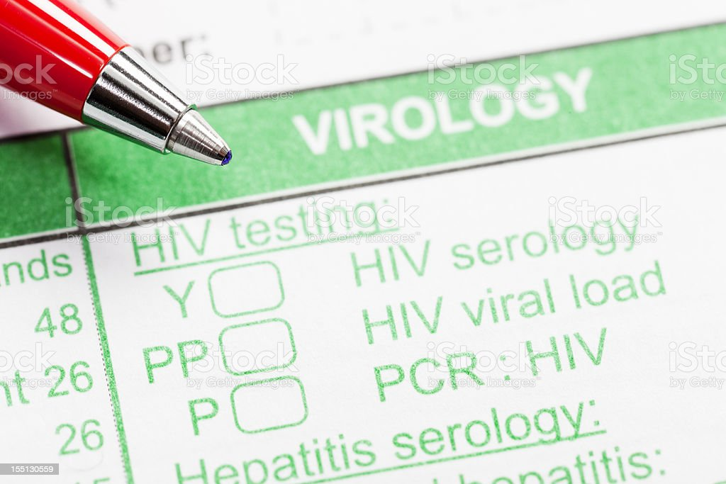 Red pen on virology form ordering HIV tests stock photo