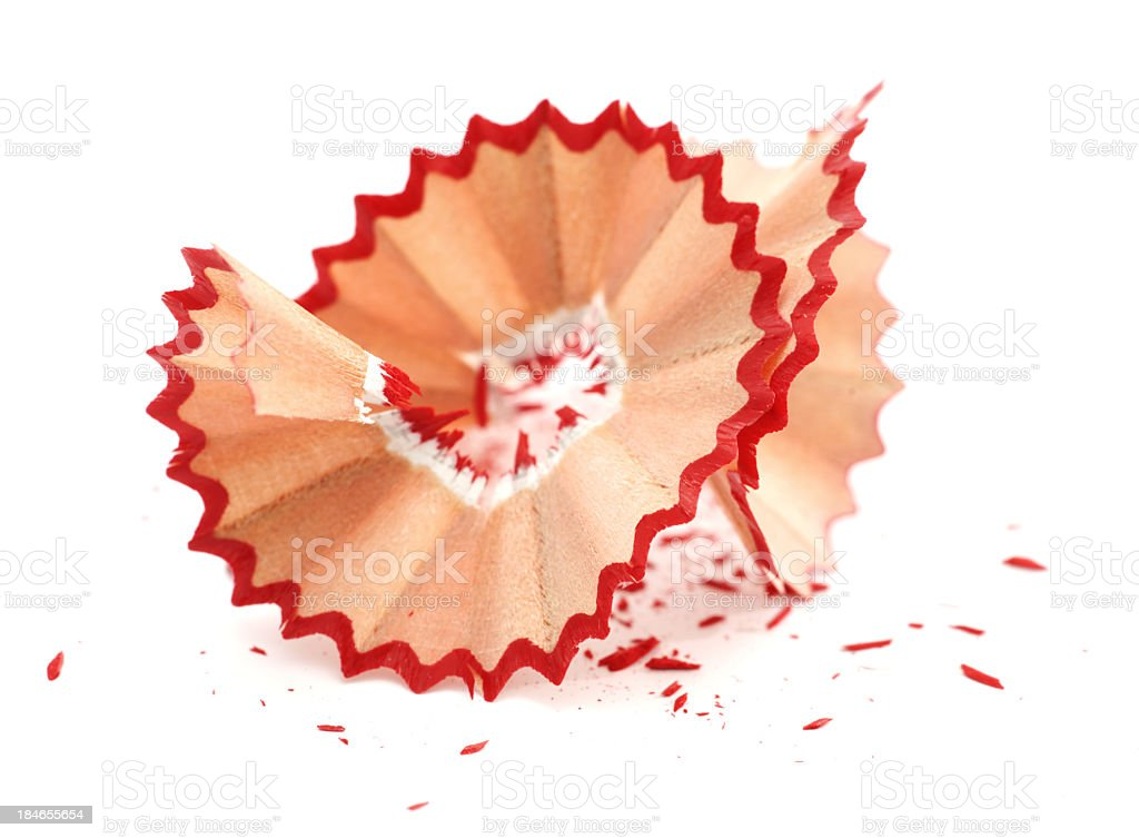 Red pencil crayon shavings on white background stock photo