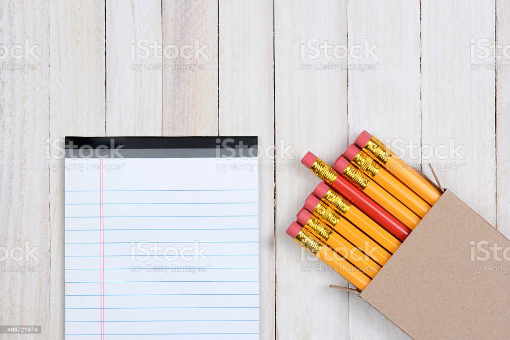 Red Pencil In Box with Note Pad stock photo