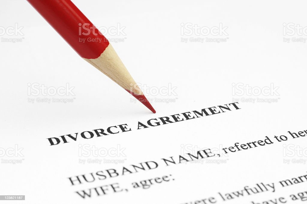 A red pencil on a divorce agreement stock photo