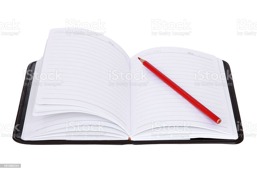 Red Pencil on a Notebook royalty-free stock photo