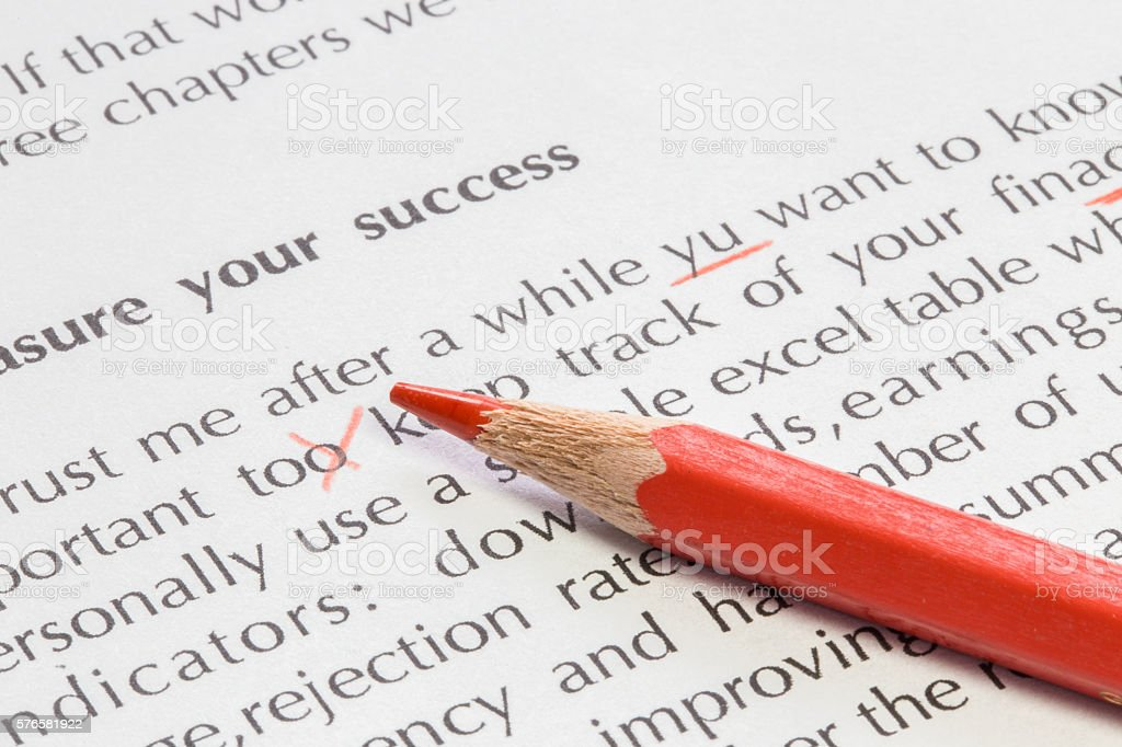 Red pencil proofreading concept stock photo