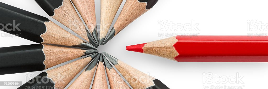 Red pencil standing out from the circle of black pencils stock photo