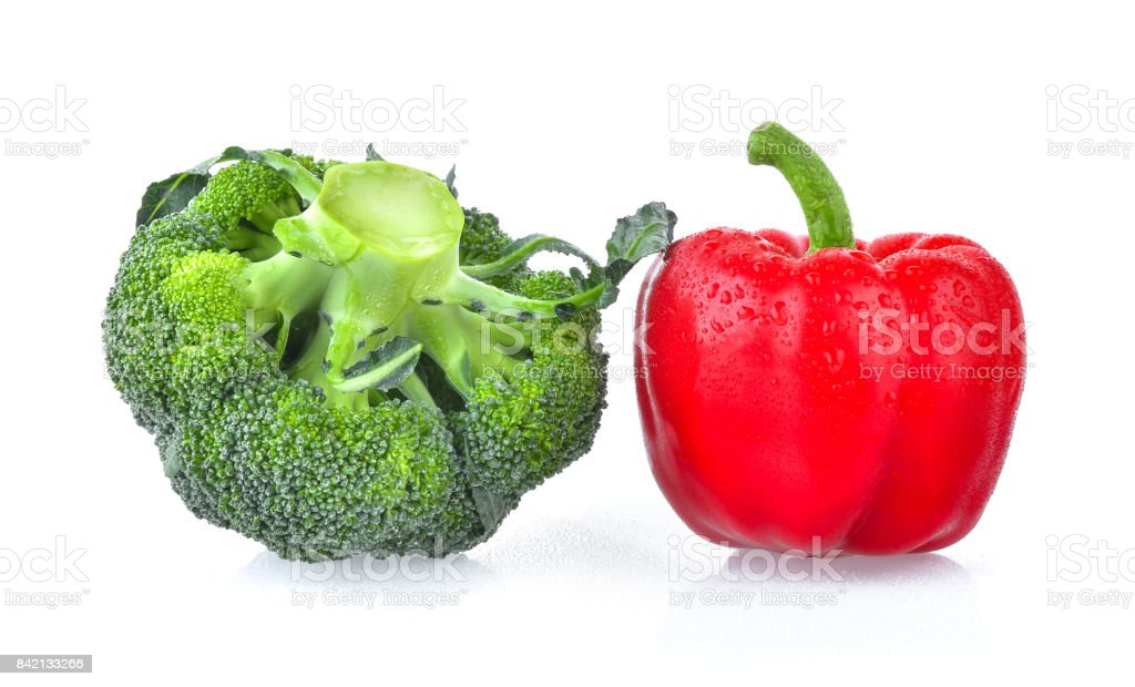 red pepper and fresh broccoli isolated on white background stock photo