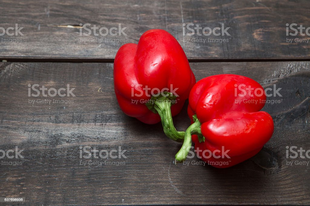 red pepper on wood stock photo
